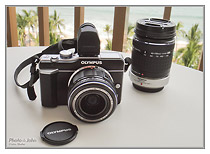 Olympus E-PL1 with kit lens and Four Thirds 40-150mm f/4.0-5.6