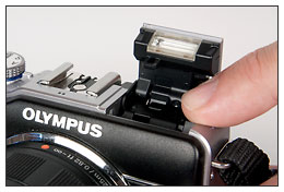 Olympus E-PL1 flash in bounce position