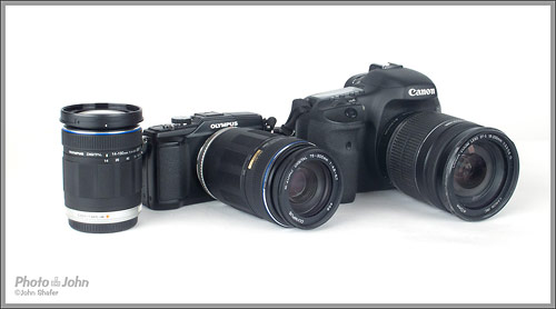 Olympus E-PL2 with 75-300mm next to Canon EOS 7D