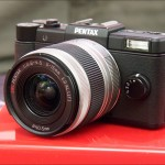 Black Pentax Q mini system camera and 5-15mm zoom lens