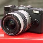 Black Pentax Q mini system camera and 5-15mm zoom lens