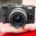 Pentax Q camera - in hand to show size