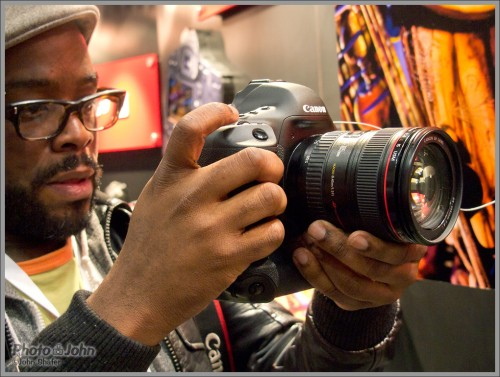 PhotoPlus Expo attendee checking out the new EOS-1D X in the Canon booth