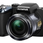 Olympus Stylus SP-820UZ iHS Superzoom Camera - Left - Front Right