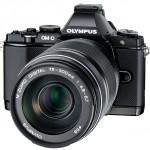New Olympus 75-300mm f/4.8-6.7 II Zoom Lens On Black OM-D E-M5 - Angle